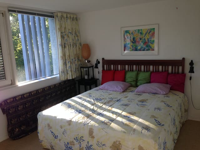 Double bed room at center beach and wood