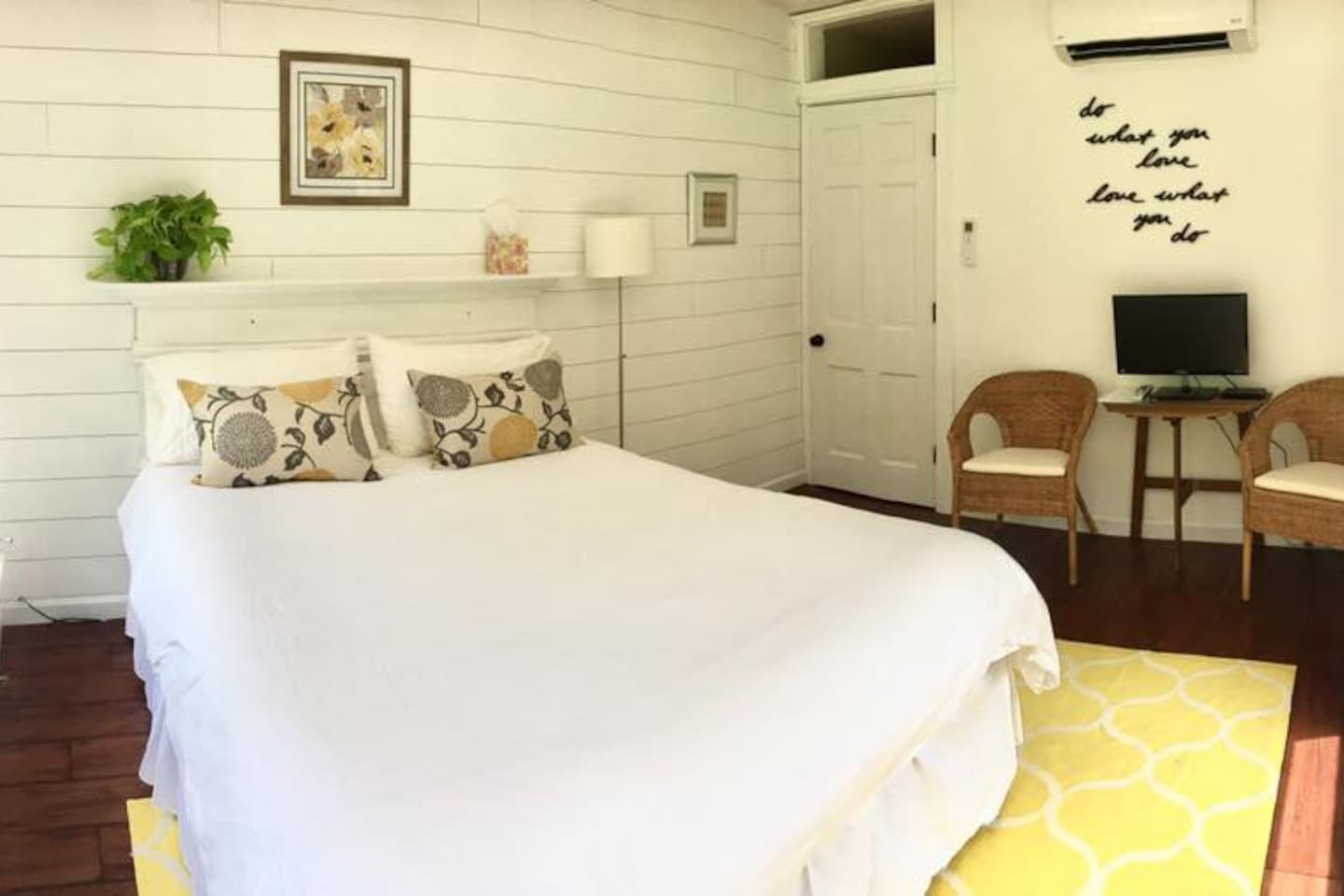 Decorated in white and gold with shiplap and antique molding.
