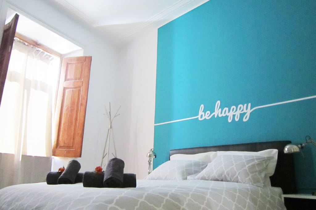 Large room with double bed, a lot of natural light