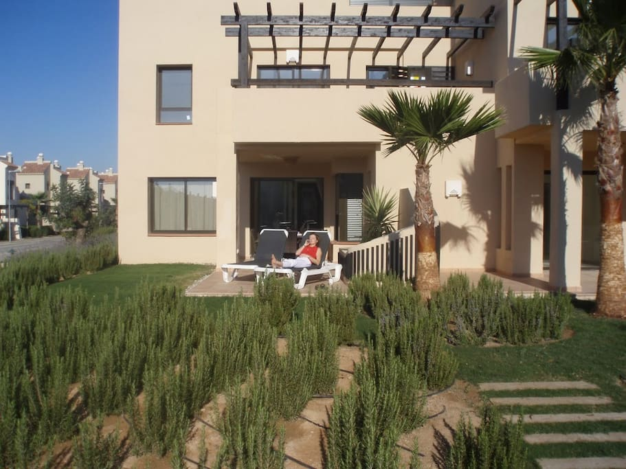 A view of the terrace and apartment from the pool.