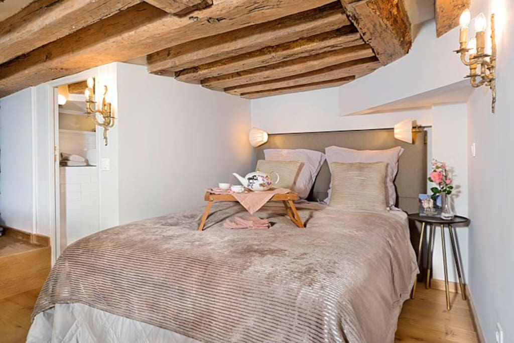 The loft area has this dreamy queen bed and a half bath.