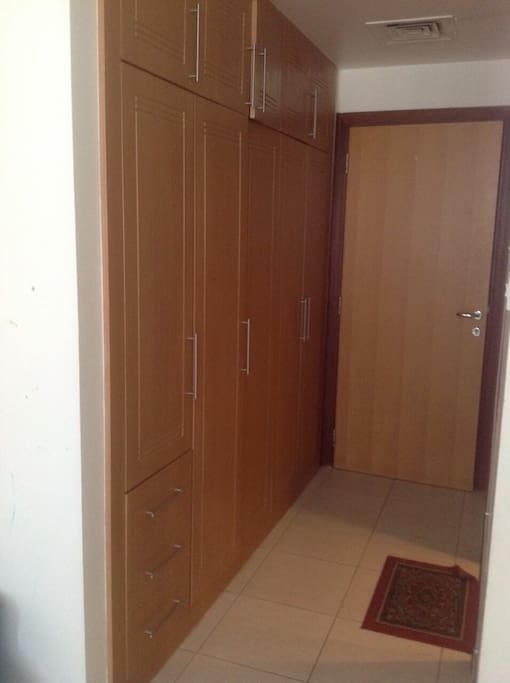 Entrance to the room with large wardrobe