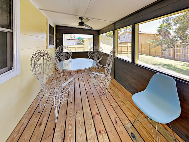 Unwind on the screened porch; a table and 4 chairs create a great space for socializing.