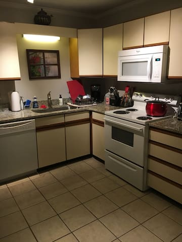 Fully equipped kitchen - everything you need to cook and serve a nice meal!  Plenty of great quality and new glasses, cookware and tableware.  Coffee, tea and some snacks and ready to make quick foods if you arrive in late and hungry!