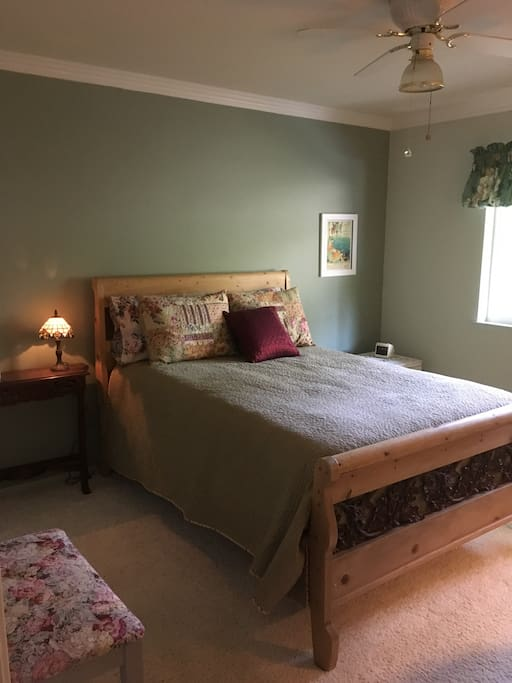 Double bed in spacious bedroom.