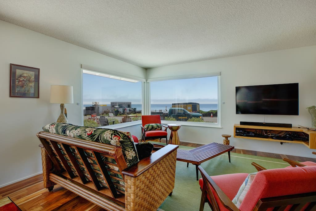 Big ocean views from living room. Electric privacy shades in living room.