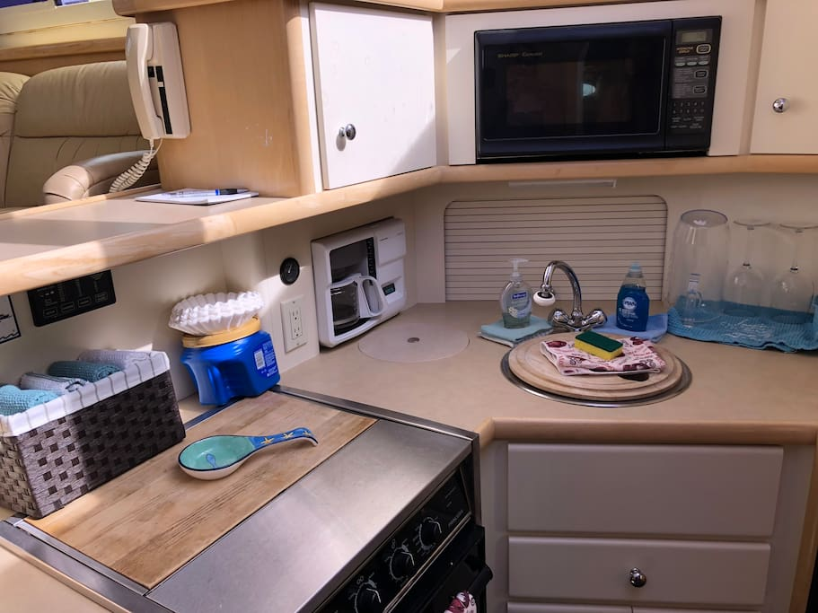 Full kitchen Stove, microwave, freezer, refrigerator, coffee pot and oven