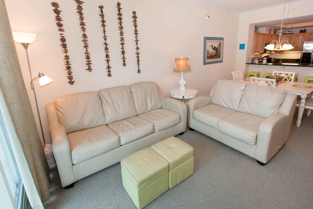 Carpeted living room with seating for 5