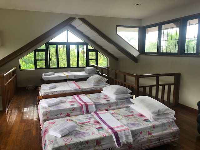 The loft bedroom has four twin beds. We can place additional folding beds, as requested.   The loft is open to the living space below and has no air conditioning.