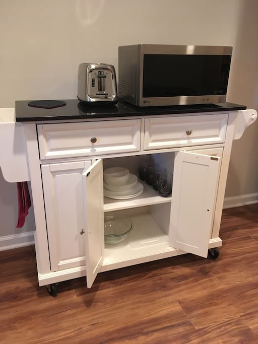 Microwave, toaster, mini fridge and coffee maker, and basic dishes/amenities