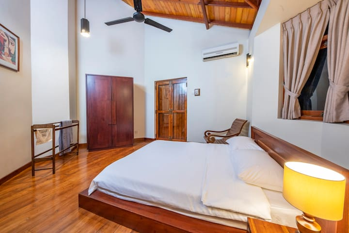 First floor Queen bed (Bed room 2)- closet - door to balcony - surrounded by tree - en-suite full bathroom - fan - AC.