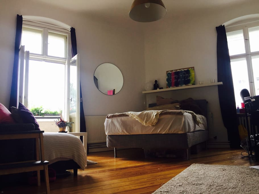 The available room. 24 m2 with balcony. Extremly comfy bed 140x200. Fairly big couch... Well full furnished. All you see stays there. Balcony is also pretty awesome, west view and  directly into the Spree/Park (see last Pics)