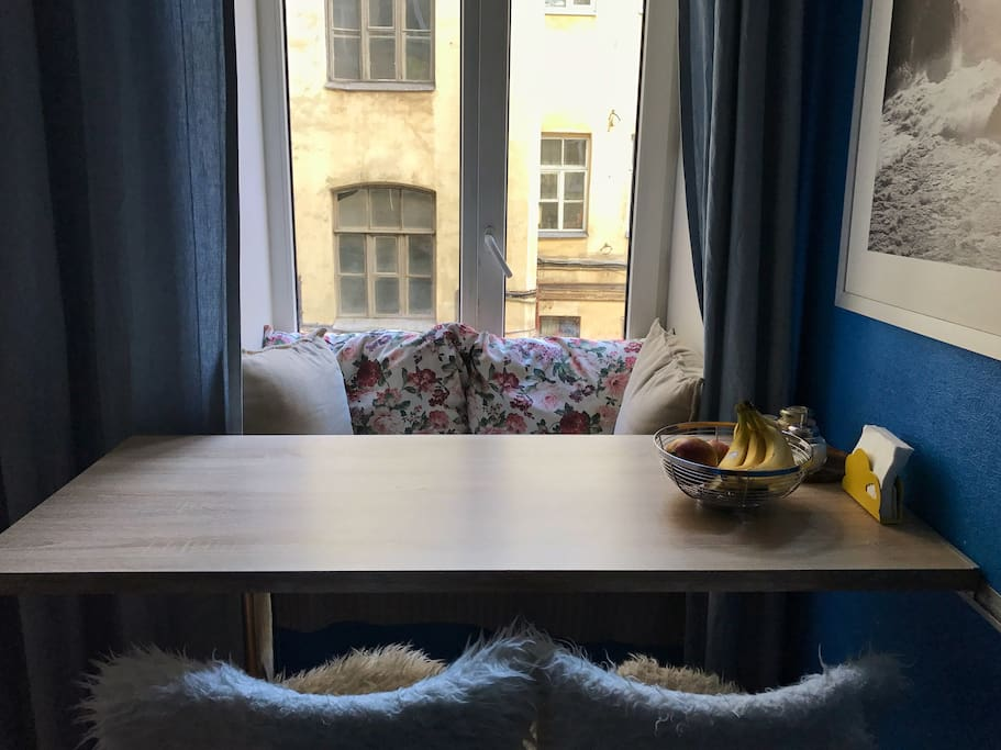 Kitchen bar table with cozy space at windowsill for nice meals