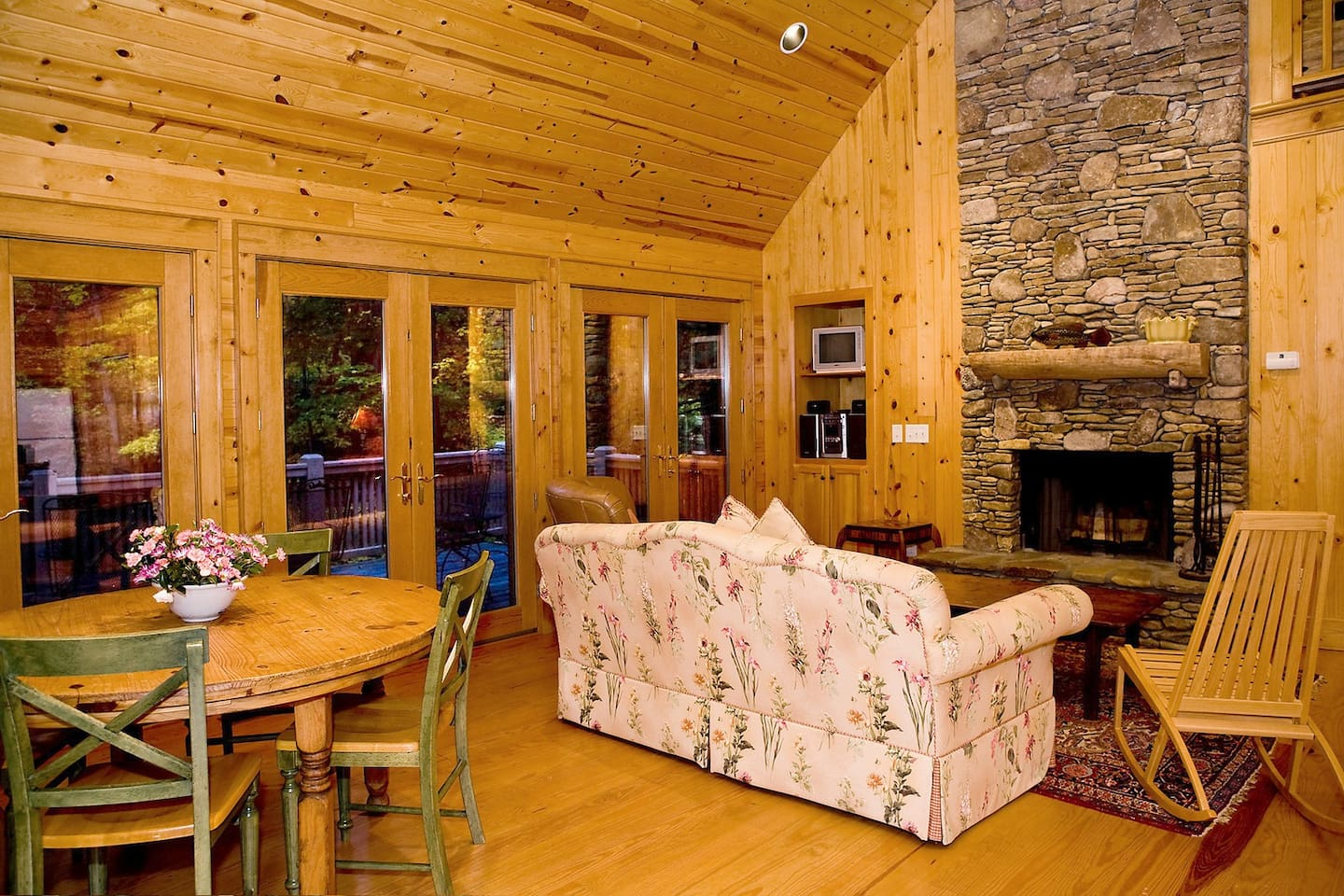 The stacked stone fireplace and vaulted ceiling