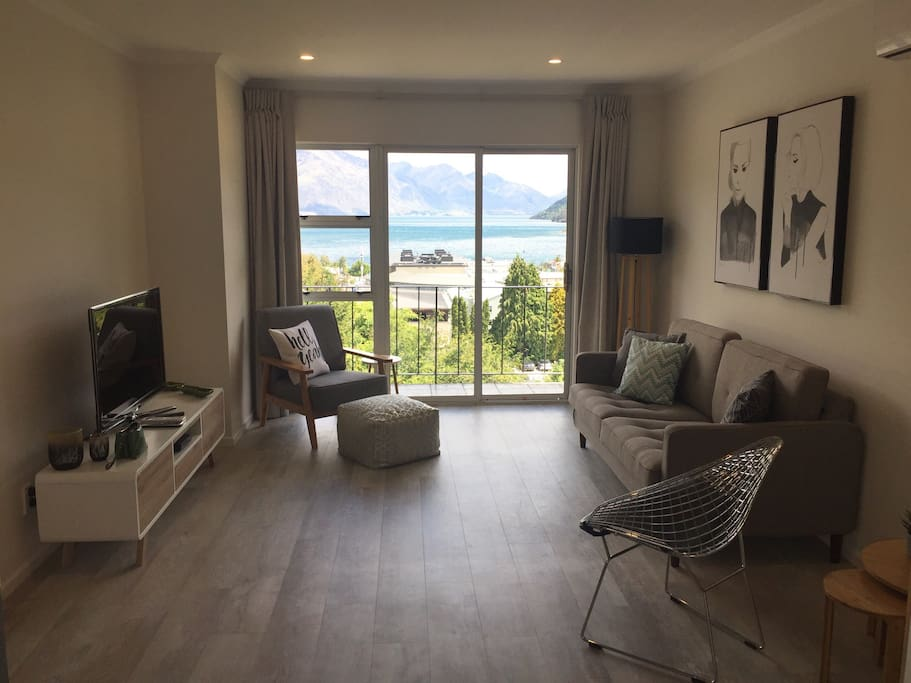 Lounge Room with amazing views of the stunning Queenstown Bay. Spectacular lake & mountain views