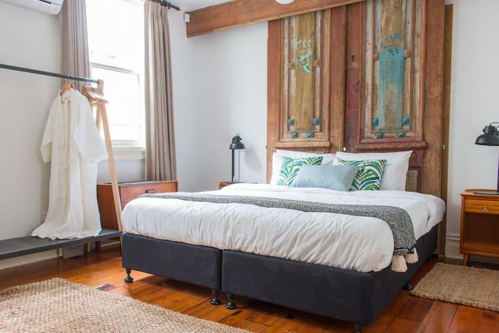 Bedroom 1 with antique feature doors