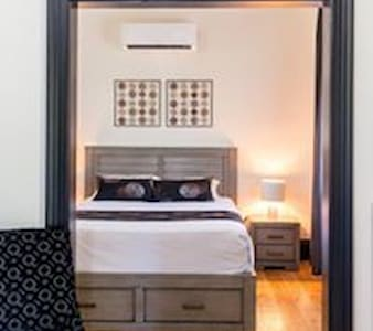 Queen bed deluxe room with separate lounge area.  Includes day bed with trundle.  Sleeps 1-4 guests.