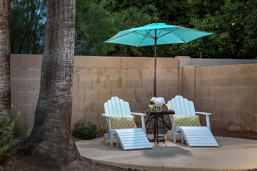 Enjoy a book in the quaint seating area in the back yard!