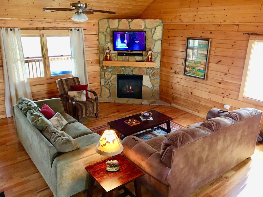 Comfortable living room with gas fire place and queen pull-out sofa bed