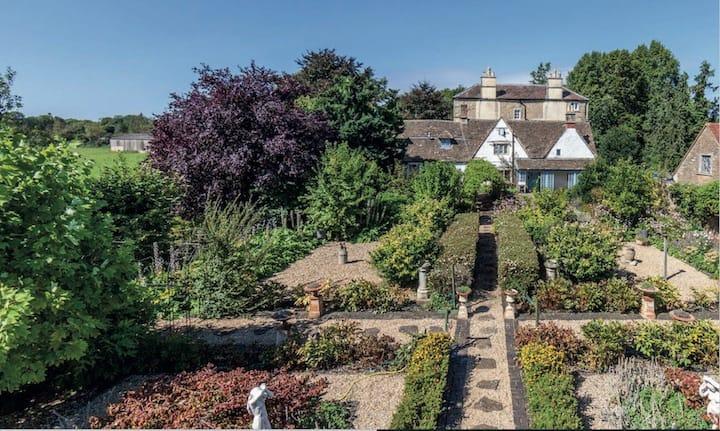 16th Century cottage set in formal gardens
