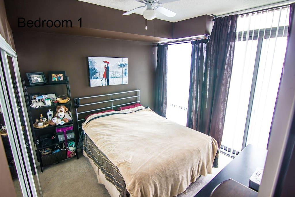 Master bedroom & exit to balcony.