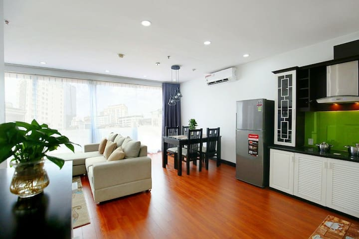 Opening Livingroom with Dinning Table and Big Fridge