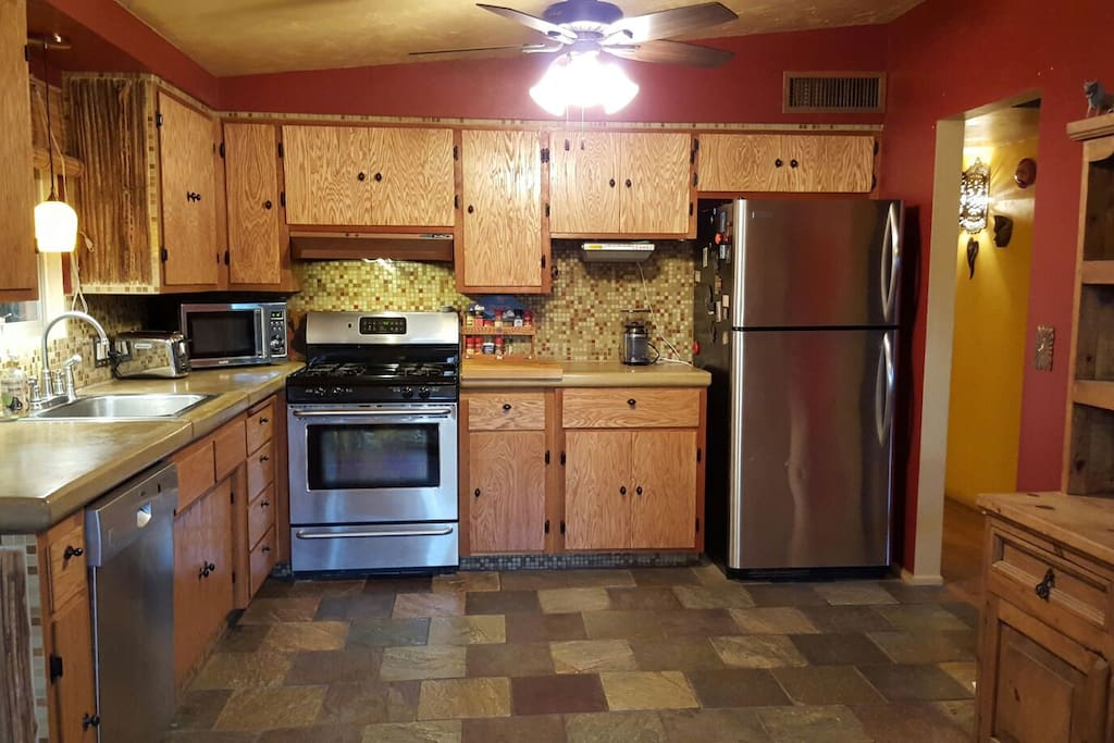 Spacious kitchen includes concrete counter tops, gas range and stainless appliances. A toaster and coffee maker are available as well.