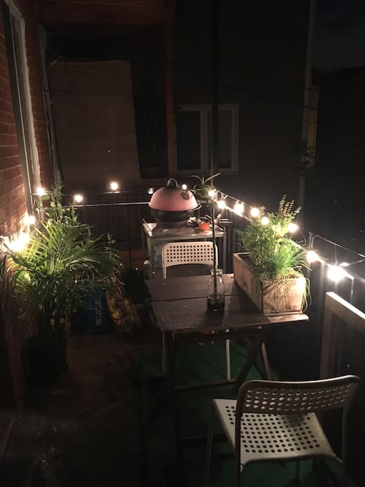 Balcony with bbq and led lights and nice plants