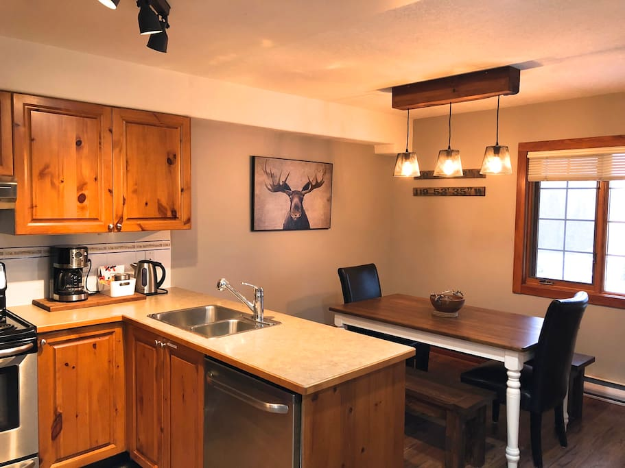 Large kitchen with everything you need to make your stay comfortable.  Table seats 8 with 2 benches and 2 end chairs.