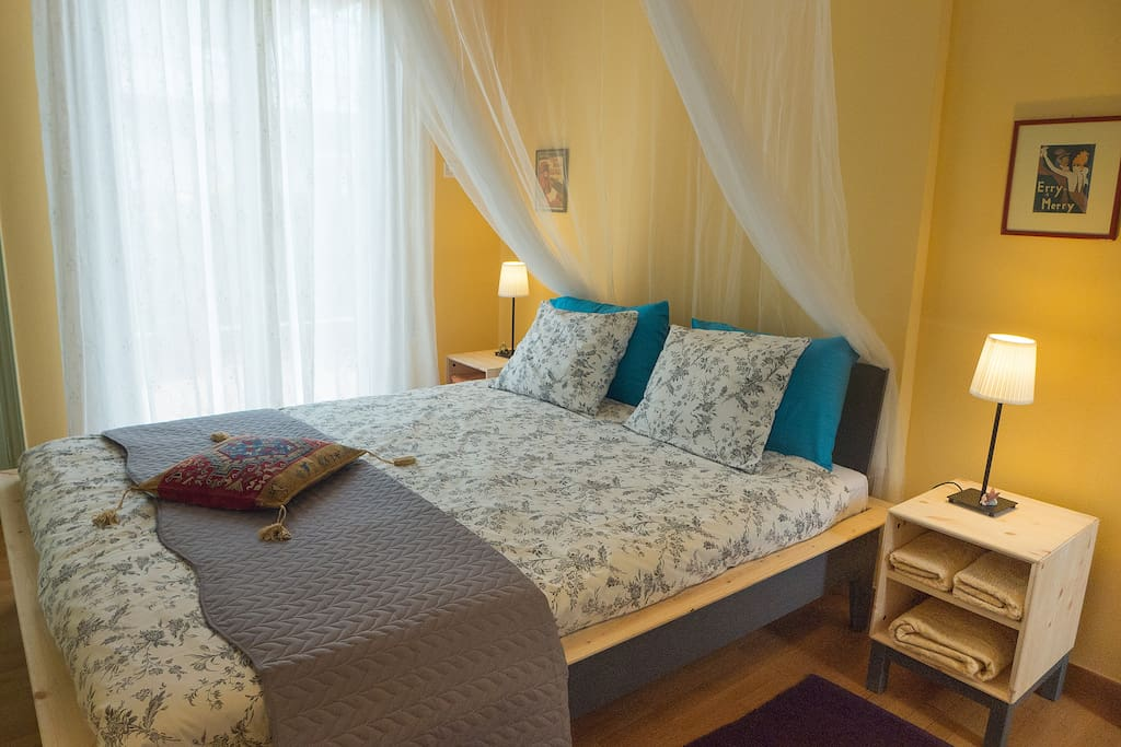 Sunny and cheerful bedroom with double bed, mosquito net, large wardrobe, fresh sheets and towels.