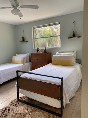 The guest bedroom has 2 twin beds and underneath two trundle beds for extra sleeping arrangements.