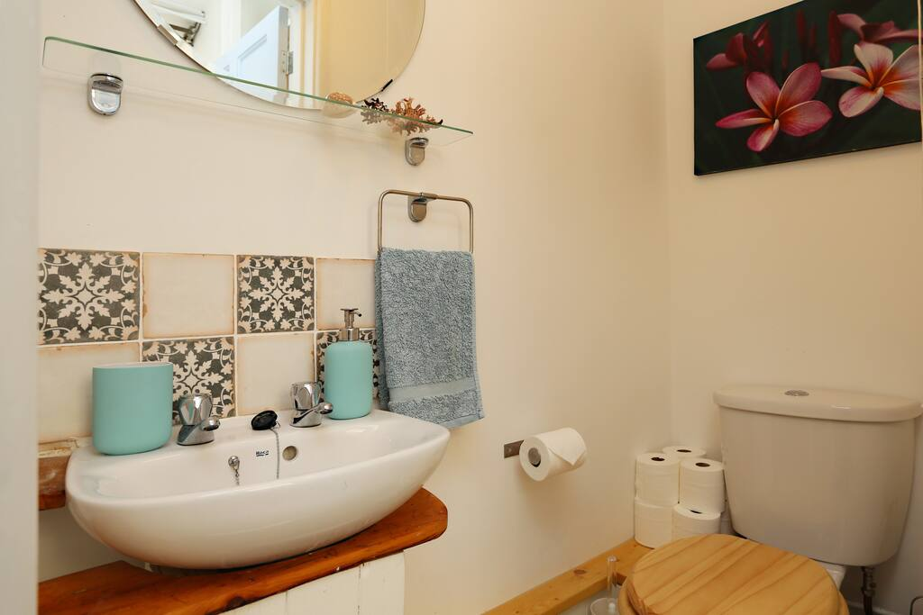 Separate toilet just outside, shared with one other guest room. Very small basin.