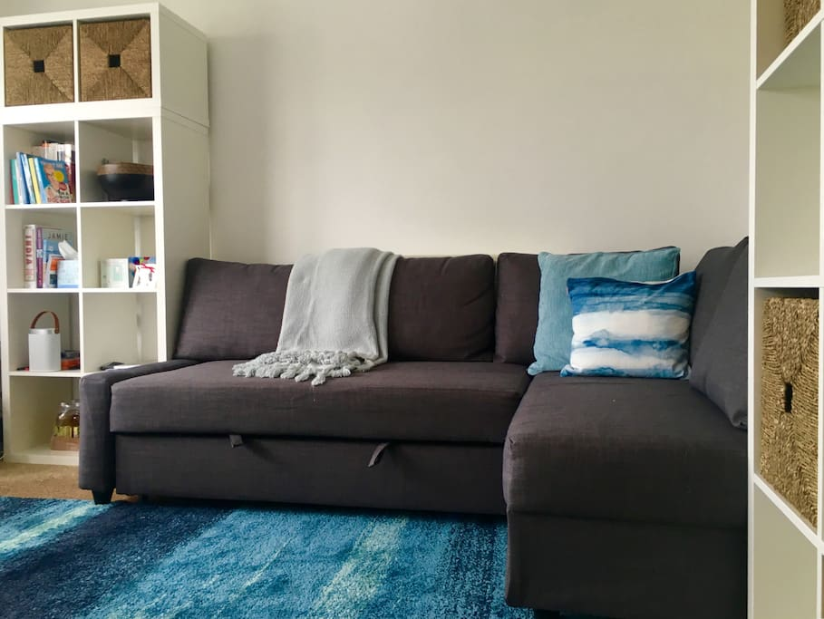 Lounge area with large sofa bed