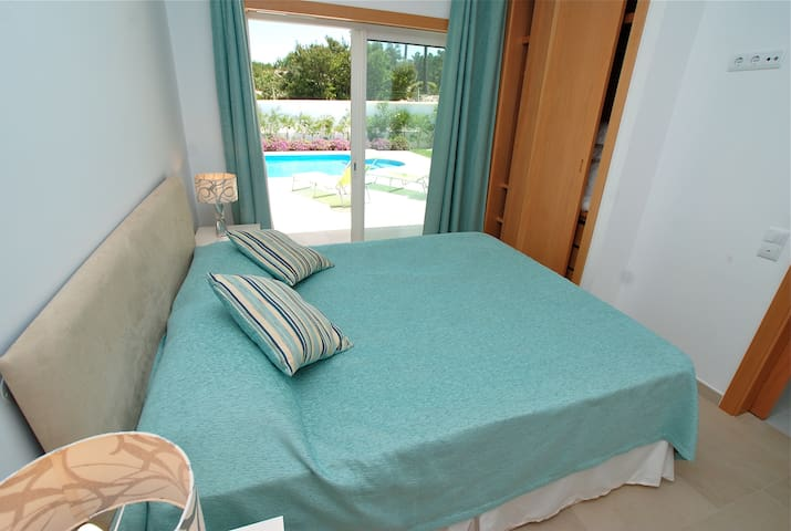 Bedroom on the ground floor with double bed and ensuite bathroom