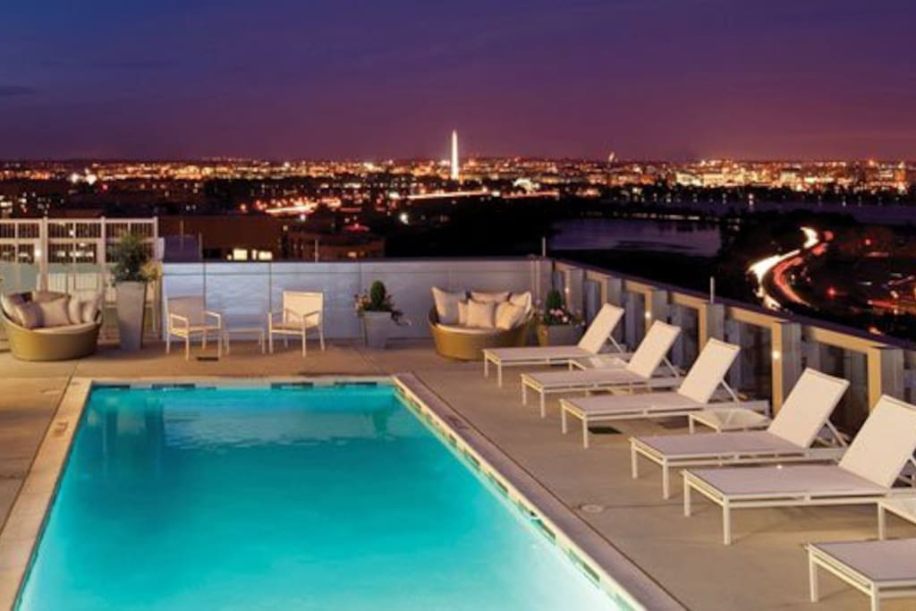 Pool and rooftop at night