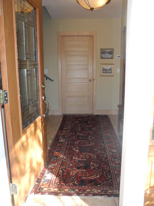 Private front door entryway with stairs up to your private spaces. You have use of entire 2nd and 3rd levels of home.