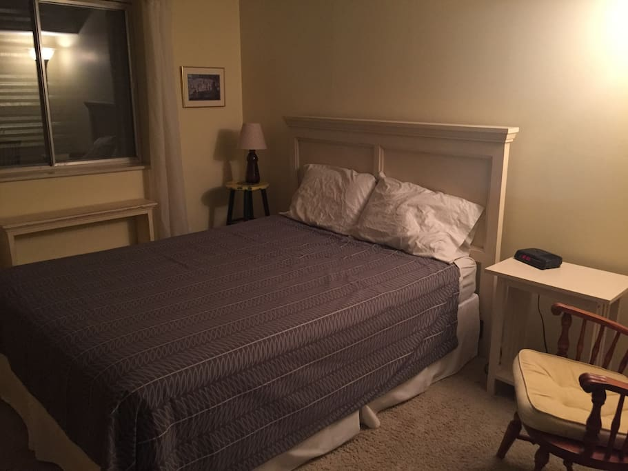 Queensize bed, closet, and luggage nook