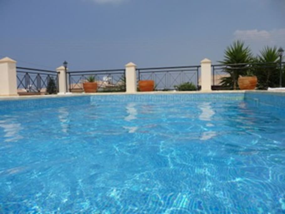 8x4 m private pool set in a spacious and sun drenched terrace with loungers and umbrellas
