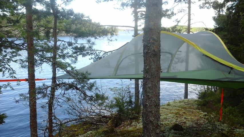 Tree tent in finnish forest by the lake of Saimaa