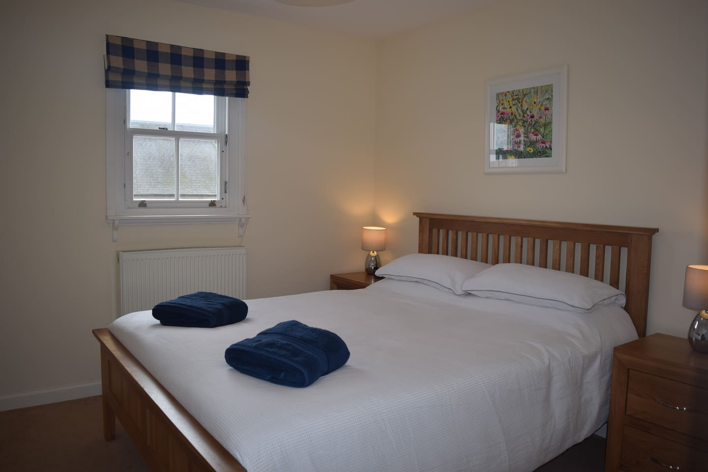 Your room with a kingsized bed and comfortable mattress.
