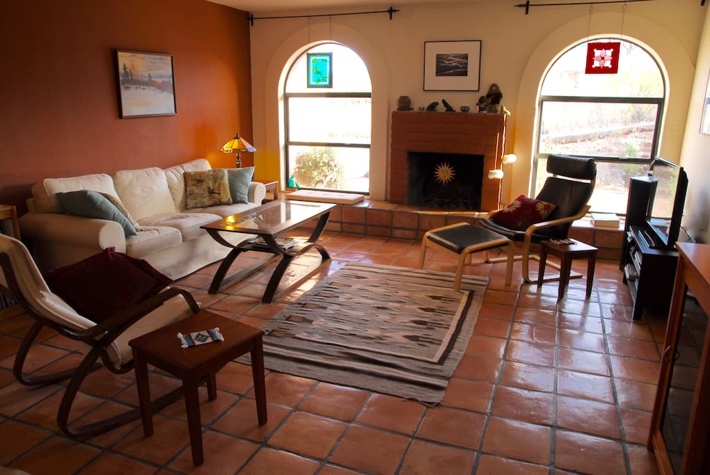 Saltillo tiles and arched windows grace the sunken living room.