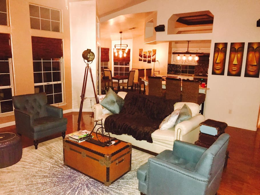 Very cozy, chic living room...with a bar for ample work space and has strategic chargers for phones placed around the house..Watch HULU, NETFLIX and AMAZON videos if you fancy staying in...