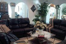 Common living room area with leather sectionals to enjoy