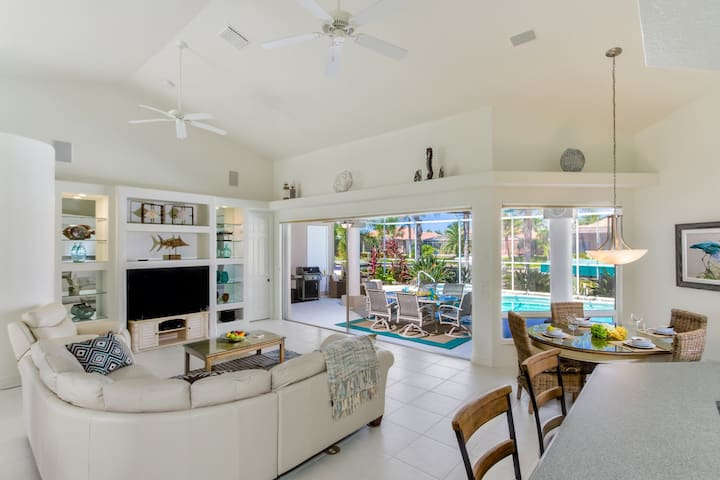 White Sands, minutes to Cape Harbor, electric heated pool/spa gulf access canal, office, bikes and 3 car garage