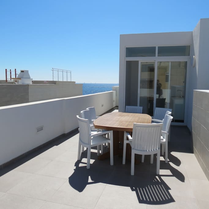 Outdoor Relaxation Area equipped with; table, chairs, Sun Loungers and Barbecue