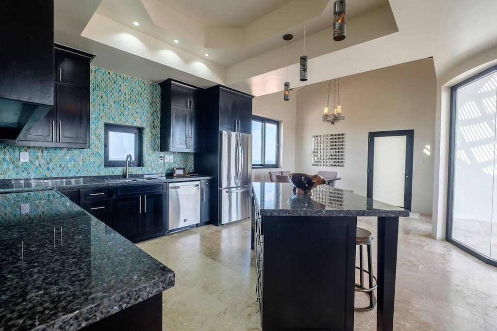 Large open kitchen and dining. With additional slider doors all open out to large patio.