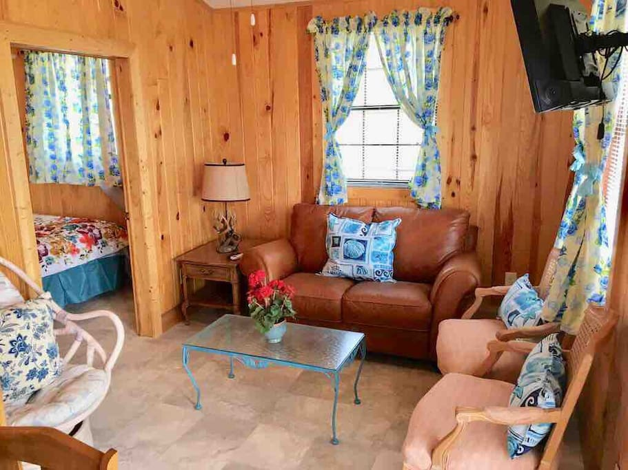 Family room, knotty pine interior, & all the comforts!