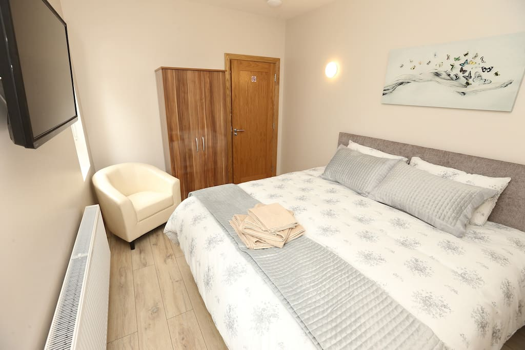 Bedroom 2 adjusted to set 2 guests, 1 x luxurious king double bed with wall mounted TV