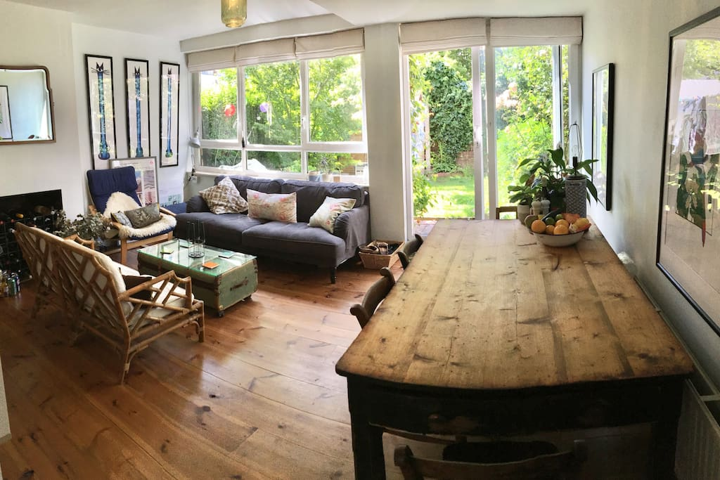 Our gorgeous outdoors-indoors dining/living room with large country farmhouse dining table and loads of comfy seating.