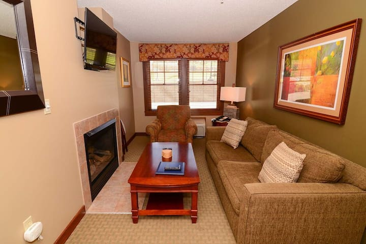 A114- 1 bedroom suite w/ standard view, private bedroom, and fireplace!